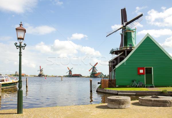 dutch windmills over river in Zaanse Schans Stock photo © neirfy