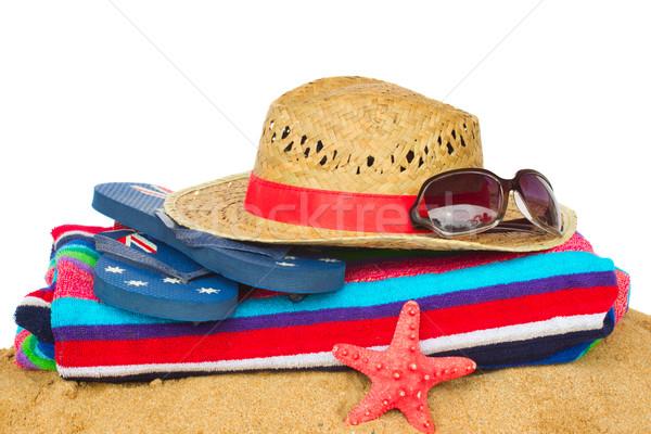 Tomar el sol sombrero de paja arena toalla de playa sandalias Foto stock © neirfy
