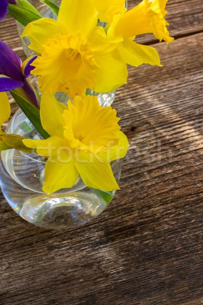 Húsvét nárcisz citromsárga virágok fa asztal virág Stock fotó © neirfy
