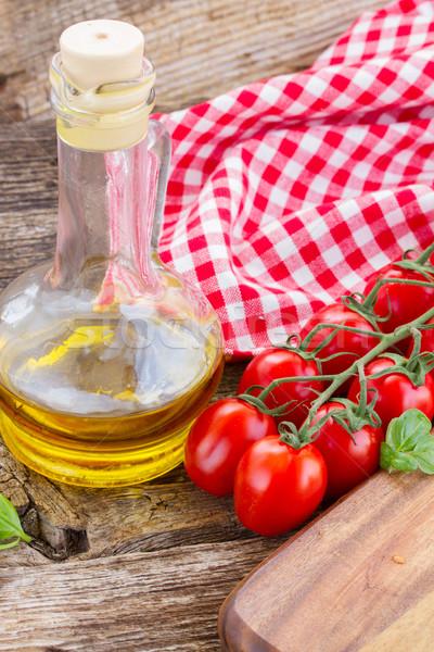 Cocina italiana aceite de oliva tomates fondo blanco cocina Foto stock © neirfy
