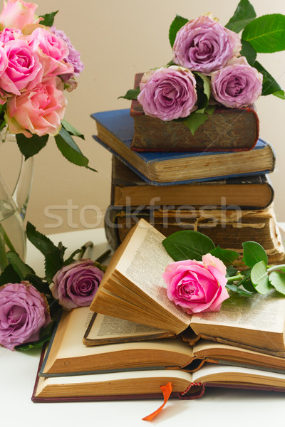 Old books with rose flower Stock photo © neirfy
