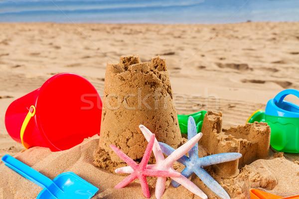 Homokvár tengerparti homok kastély tengeri csillag napos nyár Stock fotó © neirfy