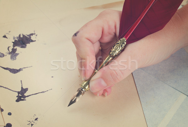 hand holding feather pen  Stock photo © neirfy