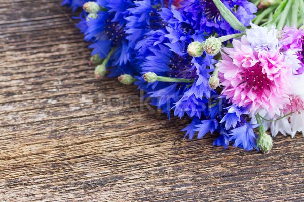Niebieski różowy świeże drewniany stół kopia przestrzeń kwiaty Zdjęcia stock © neirfy