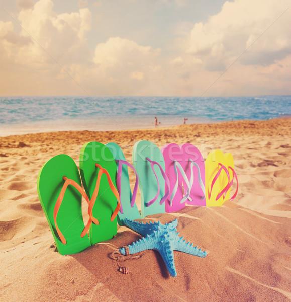 Yaz plaj eğlence ayarlamak aile sandalet Stok fotoğraf © neirfy