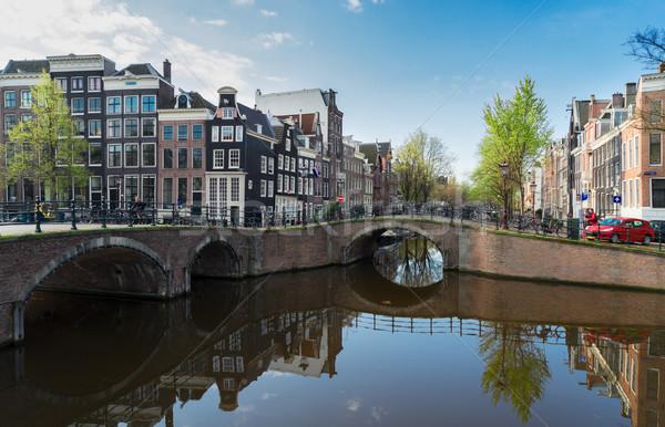 Häuser Amsterdam Niederlande Brücke Kanal Spiegel Stock foto © neirfy