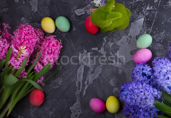 Pasen scène gekleurde eieren frame lentebloemen konijn Stockfoto © neirfy