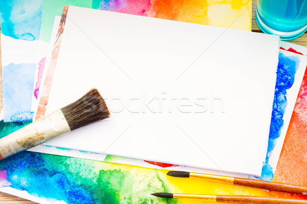 white canva with frame of paints and brushes Stock photo © neirfy