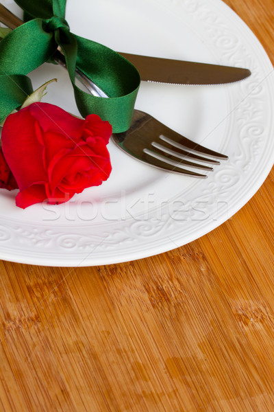 knife and fork on plate  with rose Stock photo © neirfy