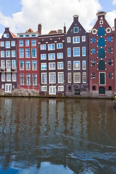 Middeleeuwse huizen water Amsterdam Nederland boom Stockfoto © neirfy