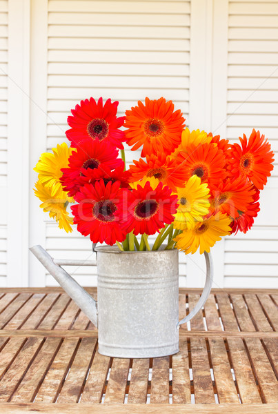 bouquet of gerbera flowers on wooden table Stock photo © neirfy