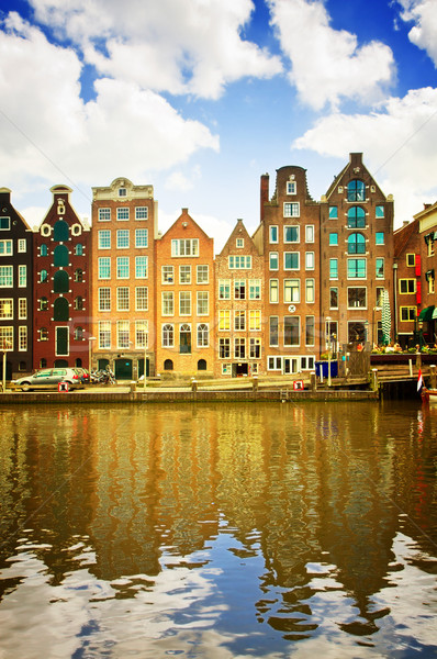 medieval houses over  canal water in Amsterdam Stock photo © neirfy