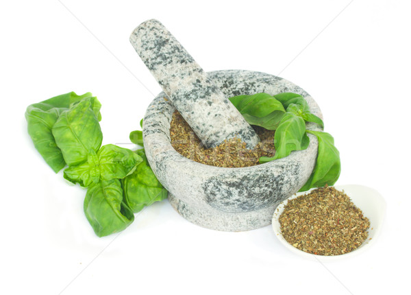 mortar with powdered basil herb Stock photo © neirfy