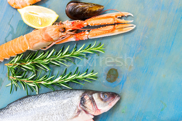 Fresh seafood on blue background Stock photo © neirfy