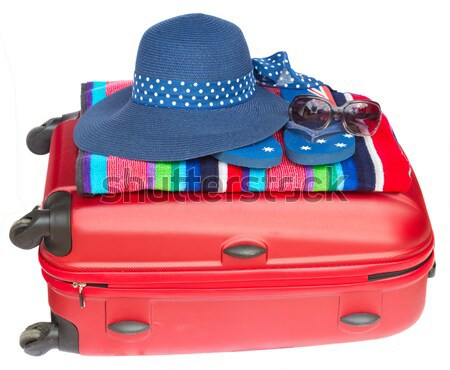 red suitcase with blue hat Stock photo © neirfy