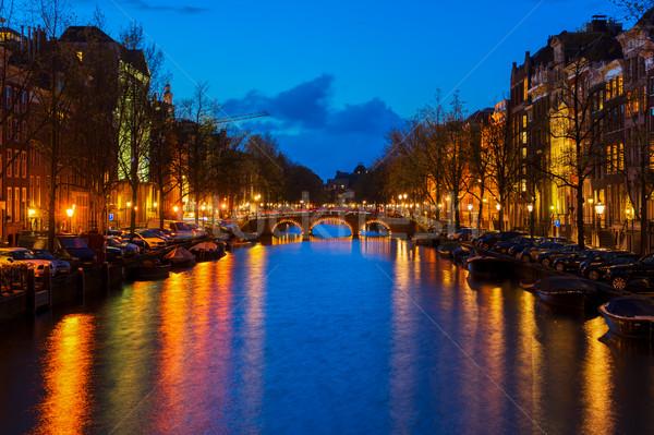 Huizen Amsterdam Nederland bruggen kanaal lichten Stockfoto © neirfy