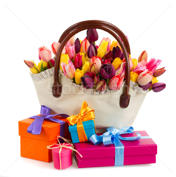 Stock photo: Bag  of tulips flowers  with gift boxes