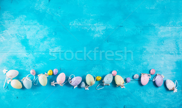 Easter eggs on bright blue background Stock photo © neirfy