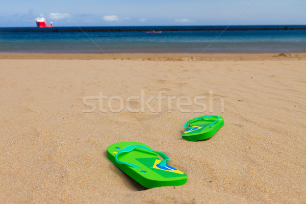 green sandals on sandy beach Stock photo © neirfy
