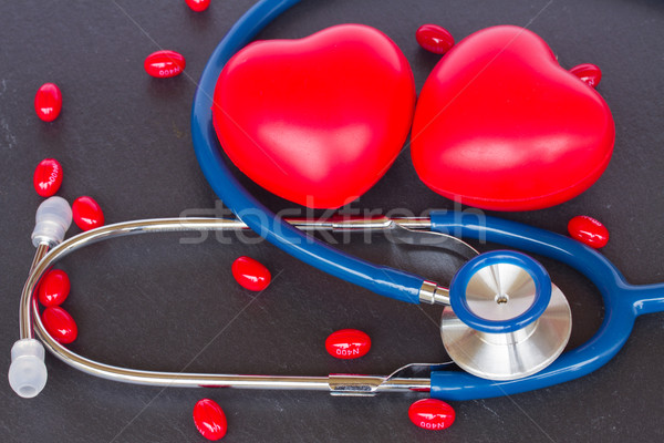 stethoscope with two red hearts and pills Stock photo © neirfy
