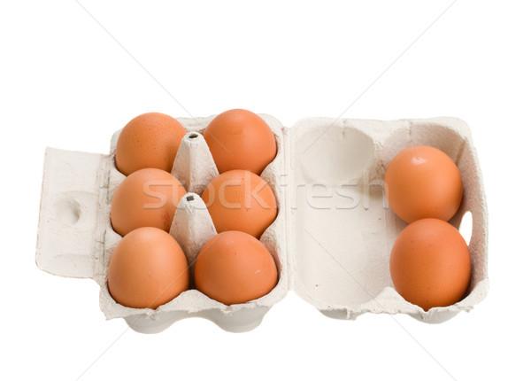 Abierto cuadro crudo marrón huevos aislado Foto stock © neirfy