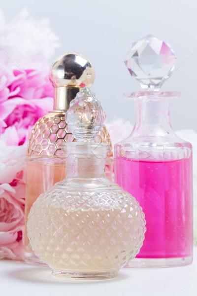 Lényeg olaj víz üveg friss virágok Stock fotó © neirfy