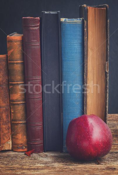 Bookshelf and apple Stock photo © neirfy