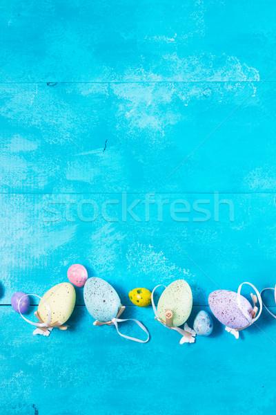 Húsvéti tojások fényes kék csetepaté copy space húsvét Stock fotó © neirfy
