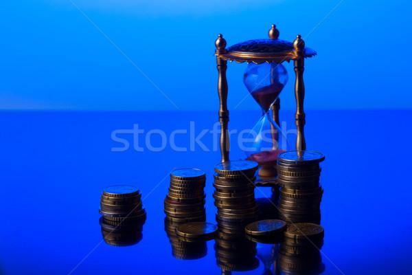 Время-деньги песочных часов евро монетами служба часы Сток-фото © neirfy
