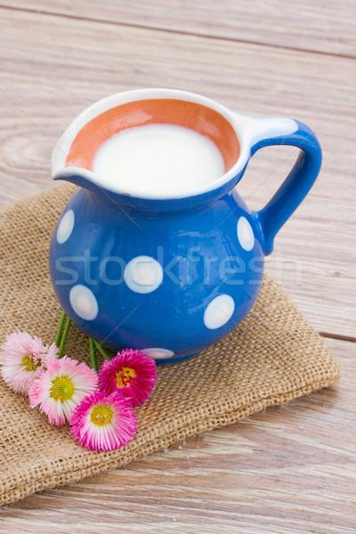 milk on wooden table Stock photo © neirfy