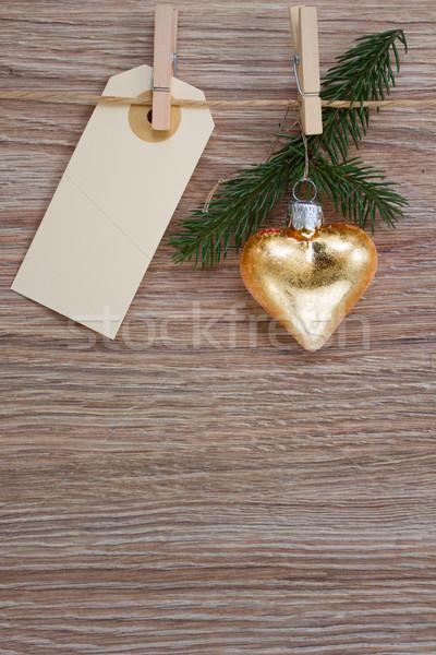 Altın kalp yaprak dökmeyen dal etiket Noel Stok fotoğraf © neirfy
