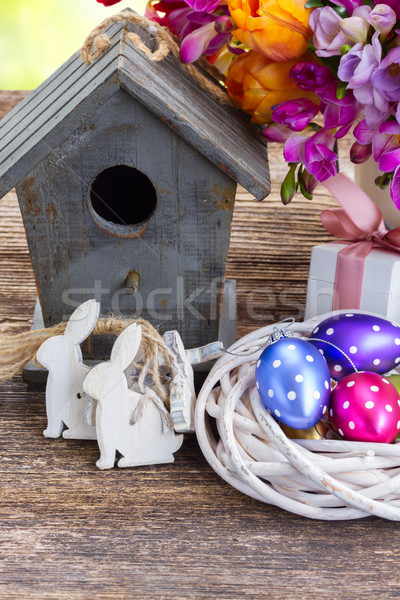 Spring rabbits with easter eggs Stock photo © neirfy