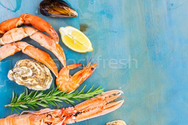 Fresh seafood on blue background Stock photo © neirfy