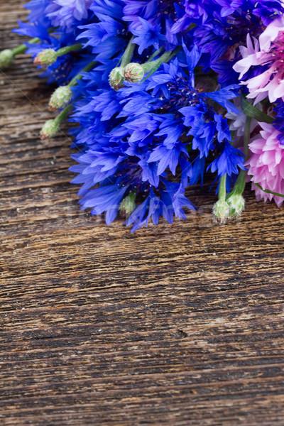 Niebieski różowy fioletowy drewniany stół kopia przestrzeń kwiat Zdjęcia stock © neirfy