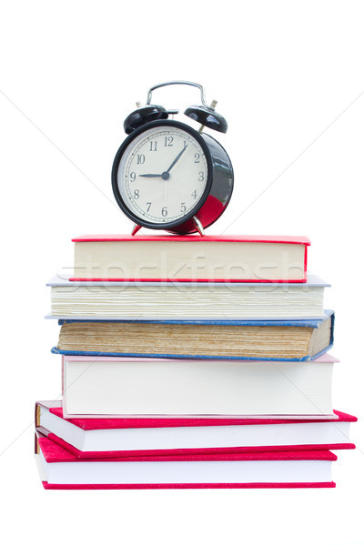 alarm clock on stuck of books Stock photo © neirfy
