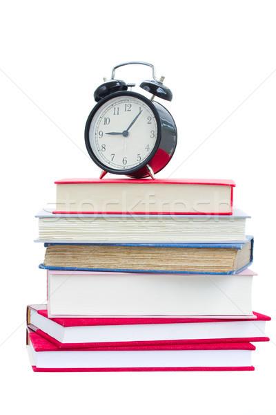 Réveil coincé livres isolé blanche livre Photo stock © neirfy