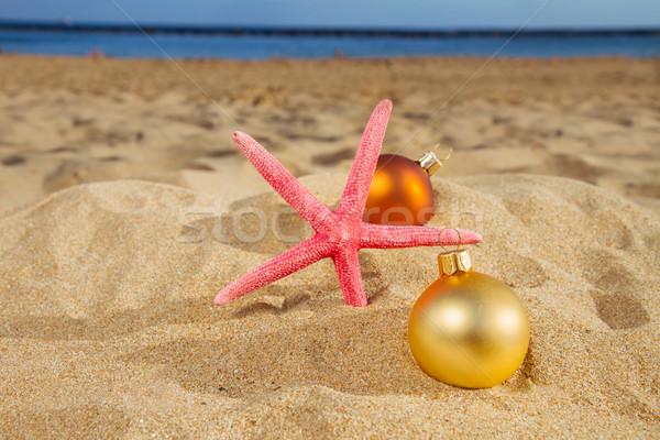 christmas balls with starfush on beach Stock photo © neirfy