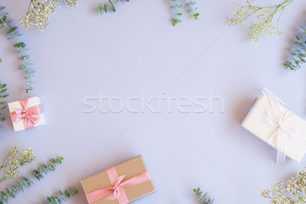 Gift boxes with green leaves Stock photo © neirfy