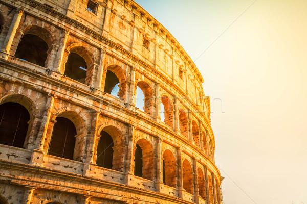 Colosseum naplemente Róma Olaszország romok napfelkelte Stock fotó © neirfy