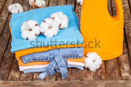 оранжевый бутылку моющее средство хлопка одежды деревянный стол Сток-фото © neirfy