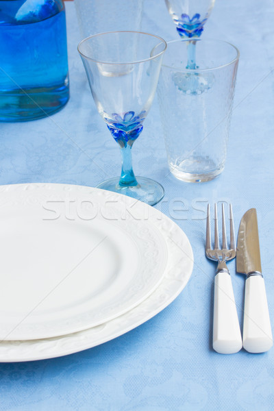 Tableware on blue cloth Stock photo © neirfy