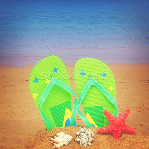 green sandals and starfish in sand Stock photo © neirfy