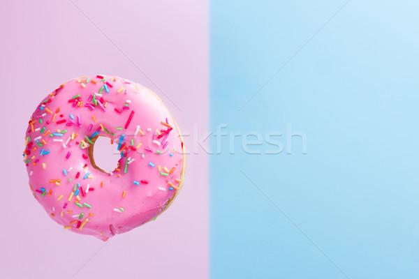 Battant bleu une relevant sweet donut Photo stock © neirfy