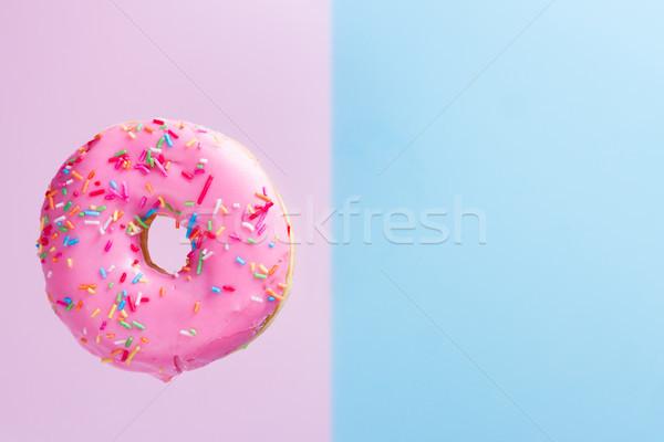 flying doughnuts on blue Stock photo © neirfy