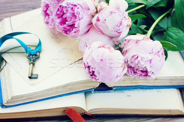pile of old books with pink flowers Stock photo © neirfy