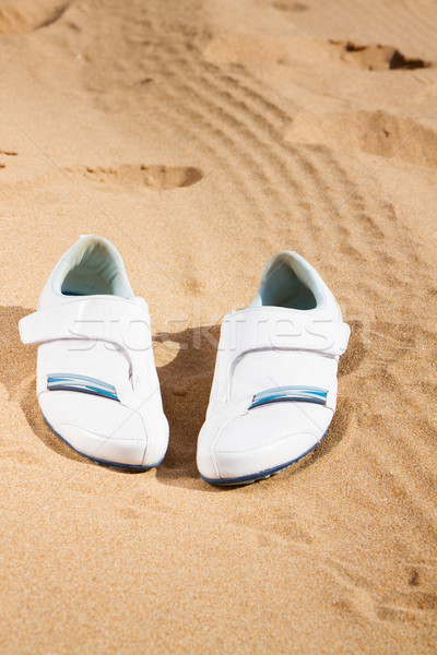 white sneakers in sand  Stock photo © neirfy