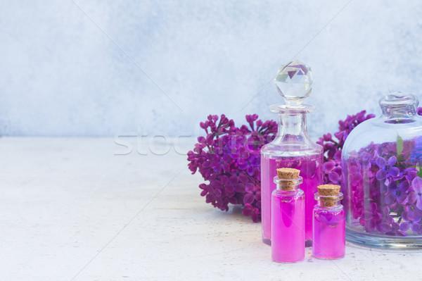Lila esencia vidrio frescos flores espacio de la copia Foto stock © neirfy