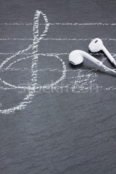 Music notes with  headphones  Stock photo © neirfy