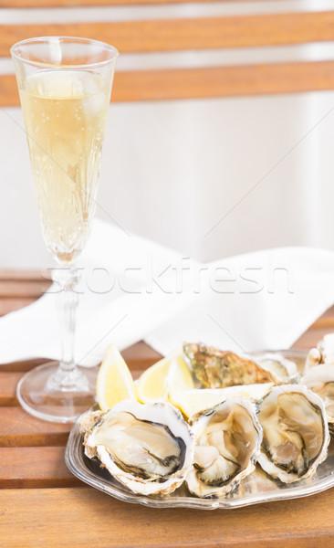Greggio conchiglie vetro champagne vino Foto d'archivio © neirfy