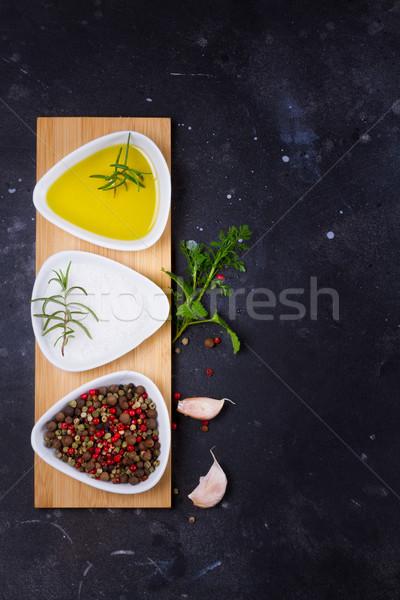 Alimentaire épices huile d'olive noir pierre fond Photo stock © neirfy